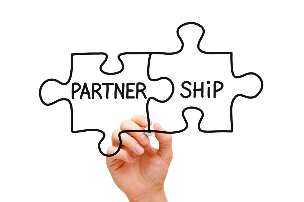 partnership puzzle pieces shutterstock_132720506